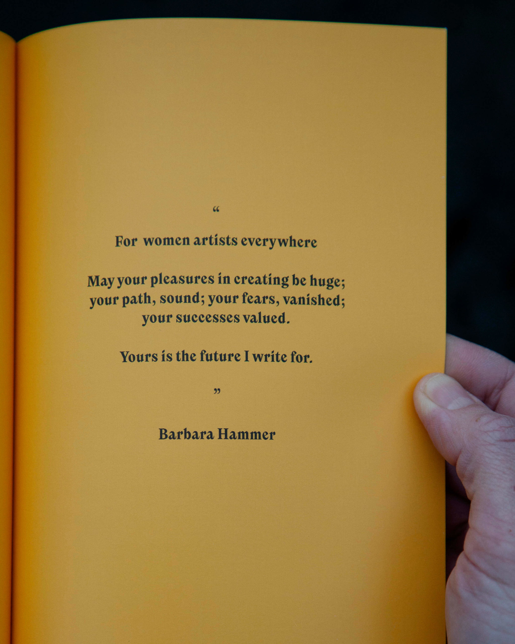 A yellow page with a quote by Barbara Hammer