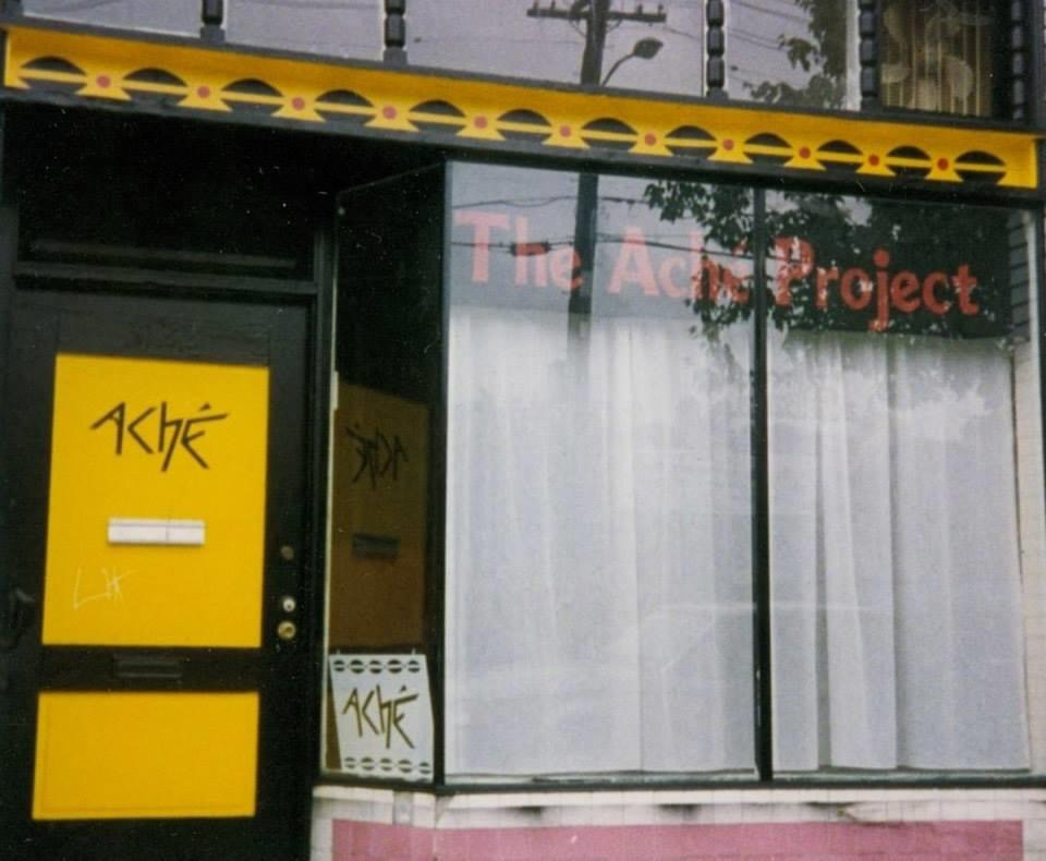 the yellow front door and a shop window to the ACHE